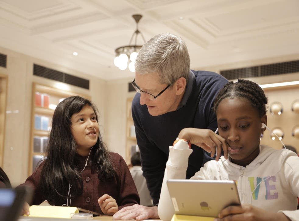 Tim Cook chats with some young coders