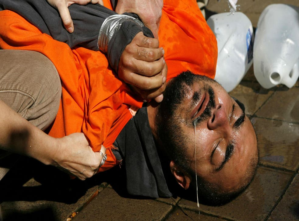 Demonstrator Maboud Ebrahimzadeh underwent a simulation of waterboarding outside the Justice Department in 2007