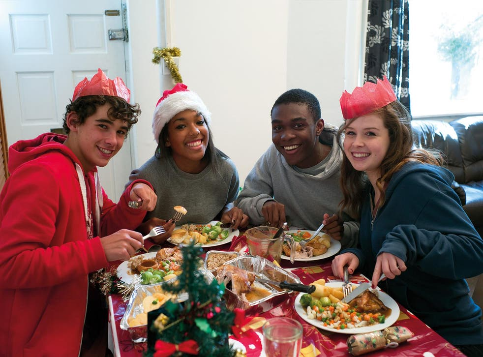 Children enjoy a Christmas lunch at Centrepoint