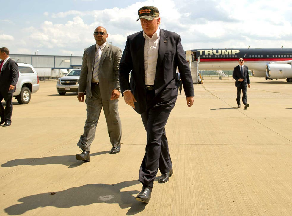 Donald Trump arrives in his plane to speak to supporters at a rally at Atlantic Aviation on June 11, 2016 in Moon Township, Pennsylvania.