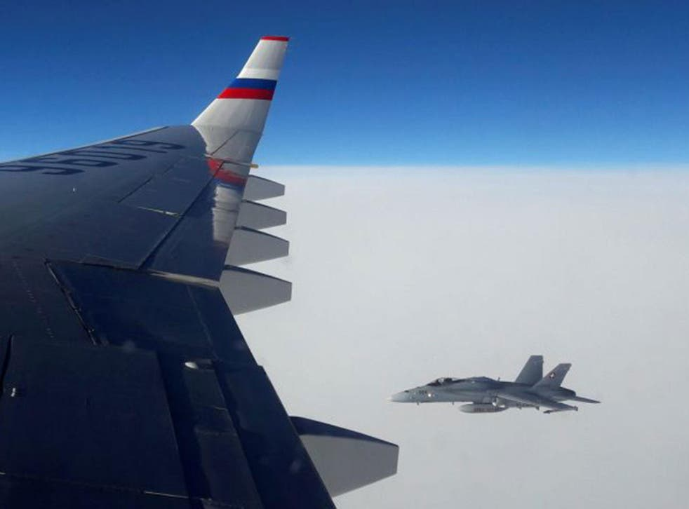 A view from the Russian plane, showing a Swiss Air Force F/A-18 fighter jet in the airspace above Switzerland