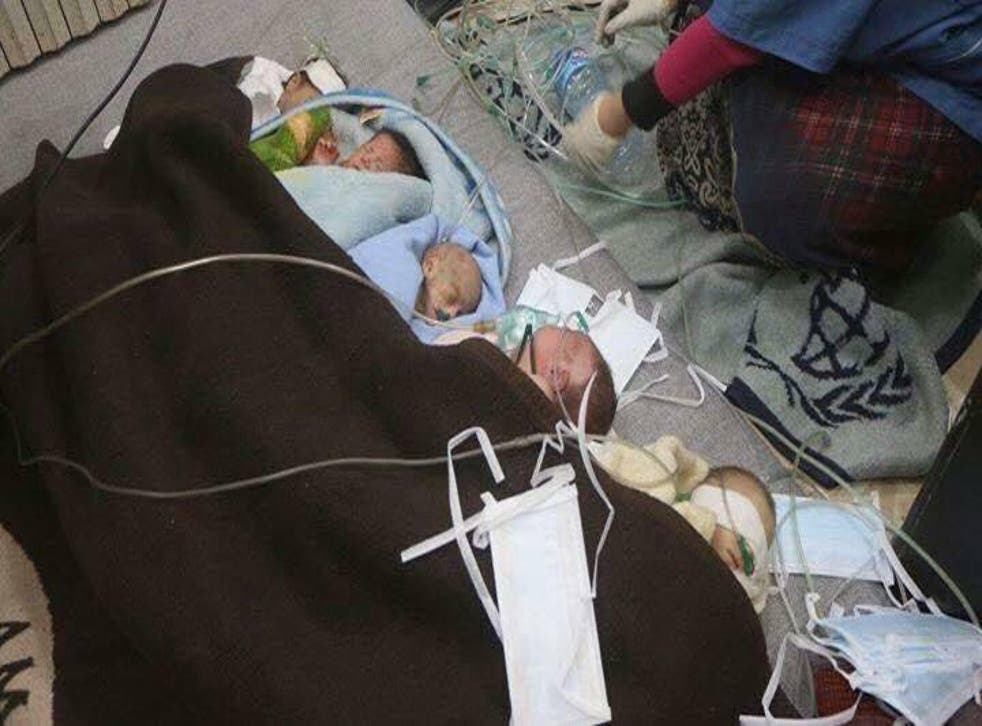Premature babies removed from incubators and treated on the floor of a civlian homeafter the bombing of an east Aleppo hospital(