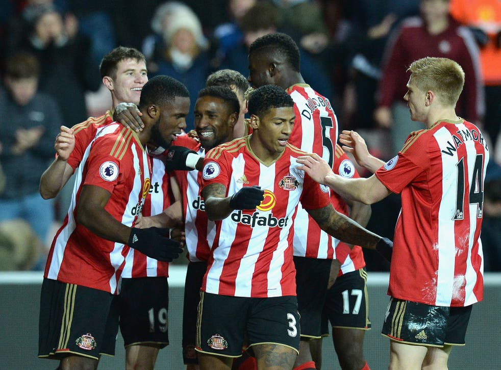 Sunderland's players celebrate Anichebe's second goal at the Stadium of Light