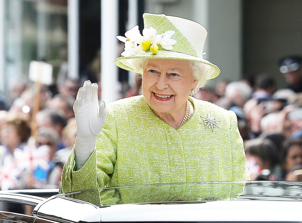 Queen Elizabeth II waves to wellwishers during a 'walkabout' on her 90th birthday in Windsor, west of London, on April 21, 2016
