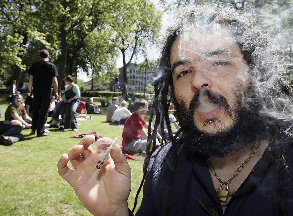 A man smoking a joint in Russell Square, London before a march against the prohibition of cannabis in the UK