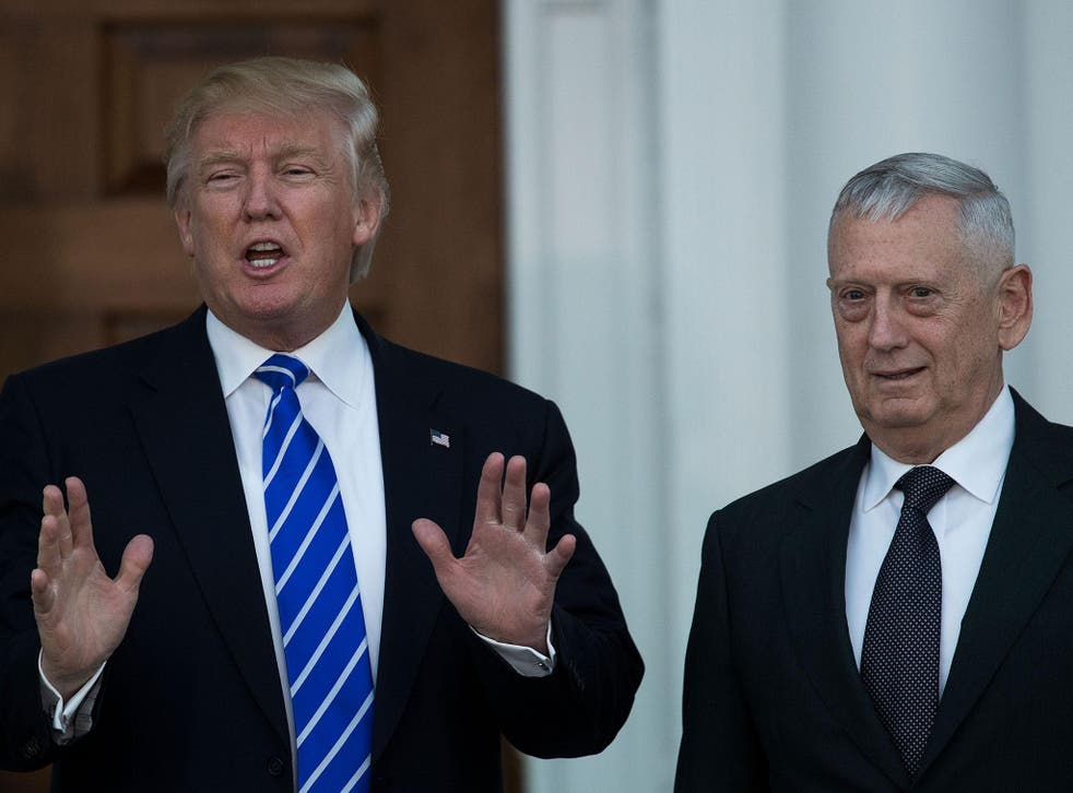 President-elect Donald Trump speaks to reporters as he stands alongside retired United States Marine Corps general James Mattis after their meeting at Trump International Golf Club, 19 November, 2016, in Bedminster Township, New Jersey