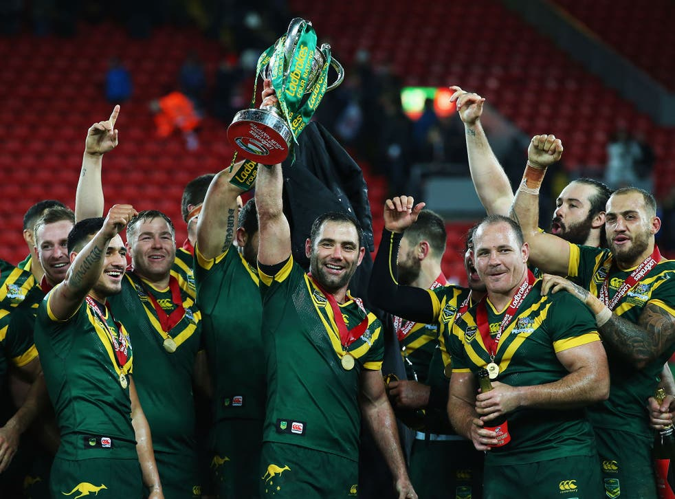 Cameron Smith of Australia lifts the trophy with team mates after victory in the Four Nations Final