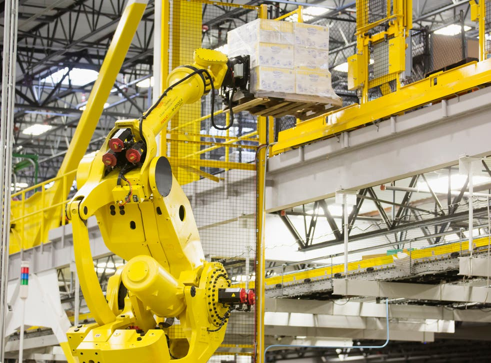 A robotic arm moves merchandise inside an Amazon warehouse in the US