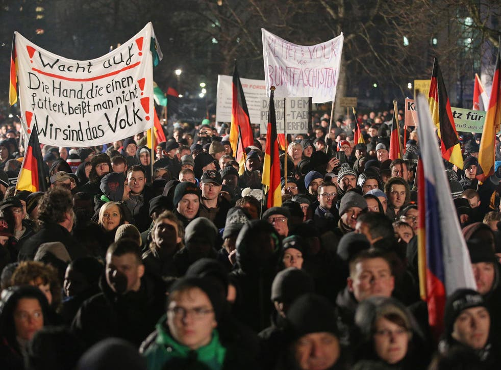 Researchers say the word 'Volksverrater' ('Traitor of the people') is increasingly heard during anti-refugee protests such as those held by the anti-Islam Pegida movement