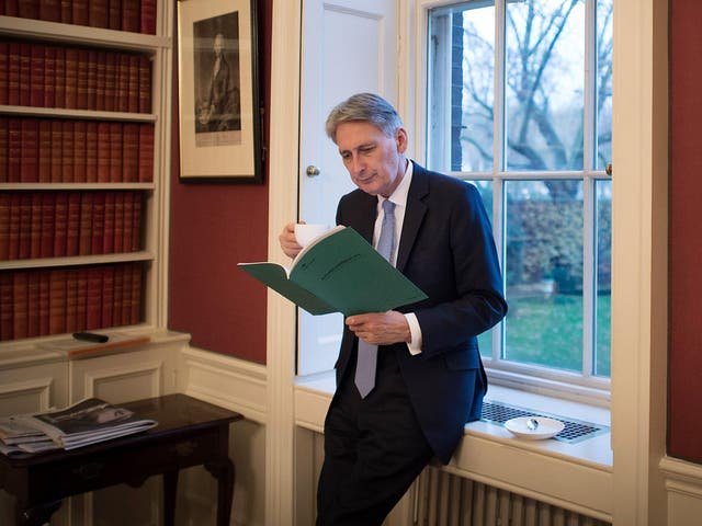 The Chancellor reads through his Autumn Statement in his office in 11 Downing Street