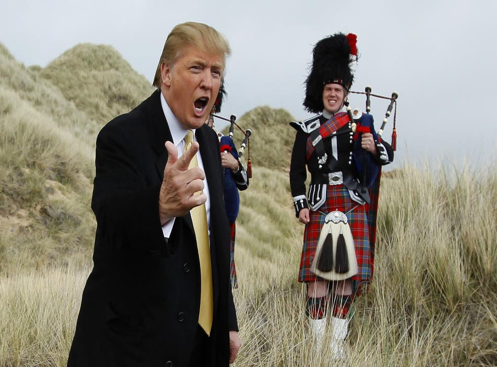 U.S. property mogul Donald Trump gestures during a media event on the sand dunes of the Menie estate, the site for Trump's proposed golf resort, near Aberdeen, north east Scotland May 27, 2010