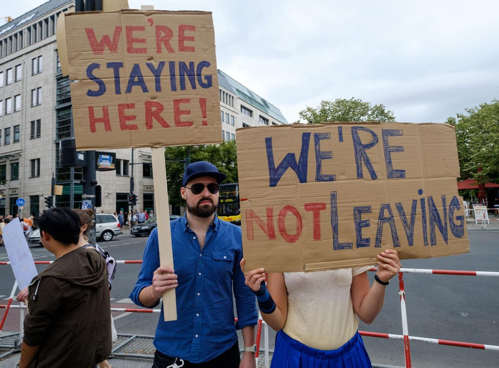 British expats hold up signs to protest Brexit
