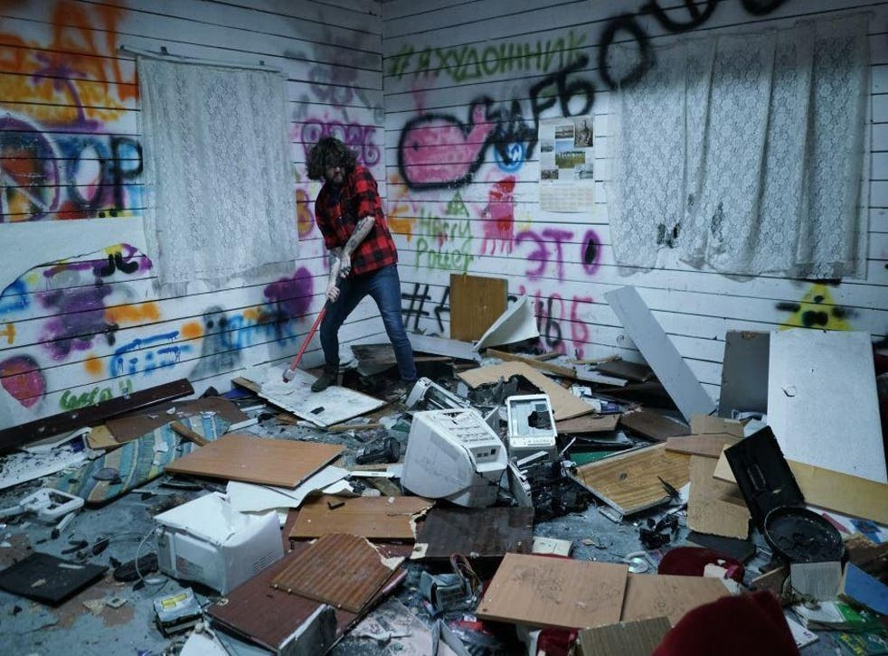 Alan Tigiev takes out his frustrations on some office equipment with a sledgehammer at a converted former secret military factory where people pay to destroy unwanted donated goods. Much of the proceeds go to charity
