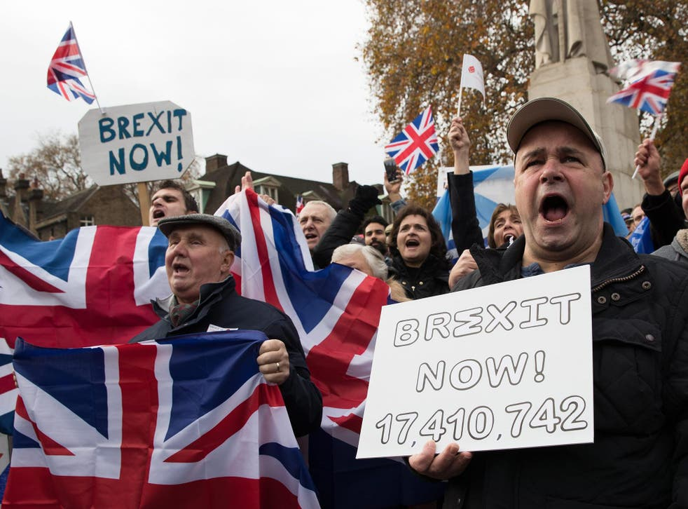 Participants of a demonstration calling for Brexit shout holding banners written 'Brexit now' at the Old Palace Yard in London