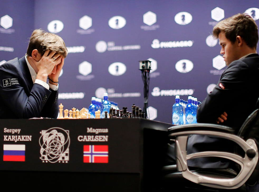 Mind games: Sergey Karjakin contemplates his move against Magnus Carlsen during round nine of the final last week