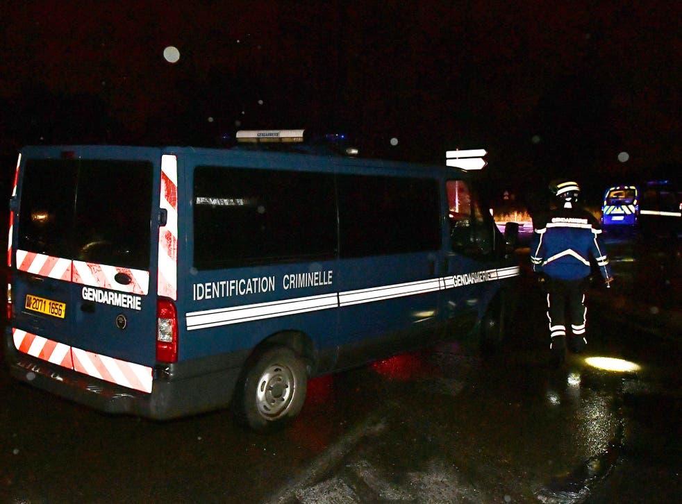Gendarmes stand guard near a retirement home in Montferrier-sur-Lez, France, following an attack on 24 November