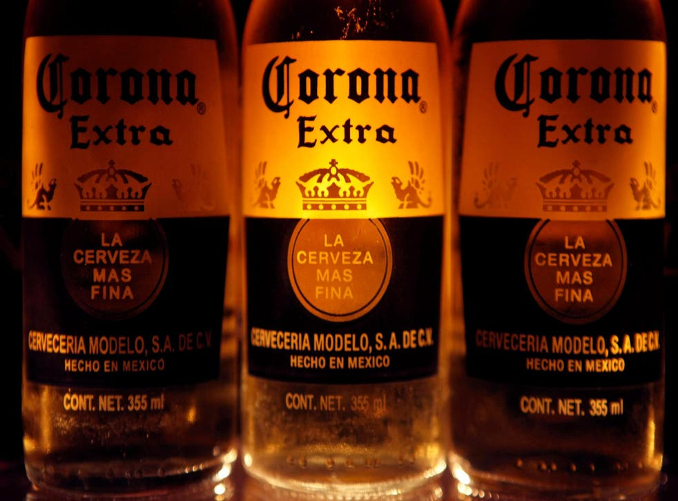 Bottles of Corona beer, the flagship brand of Group Modelo, are seen in Mexico City