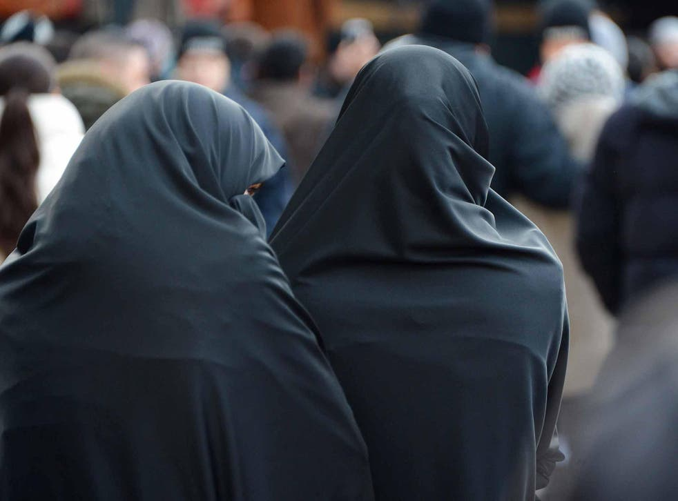 The deal included a ban on Muslim veils such as the burka and niqab, which cover all or most of the face