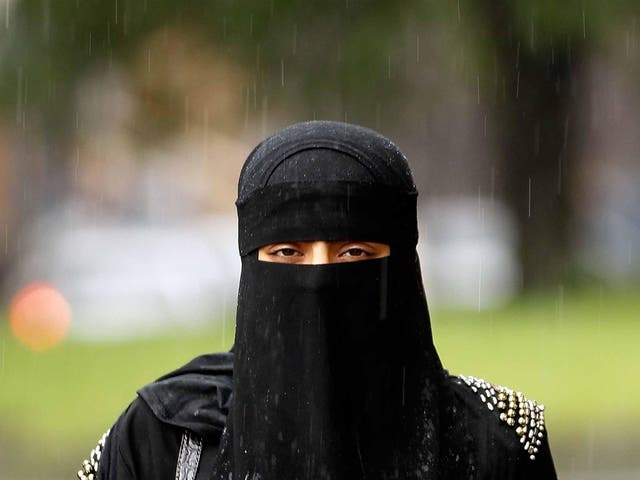 A woman wears a full-face Muslim veil - a garment to which far right groups oppose