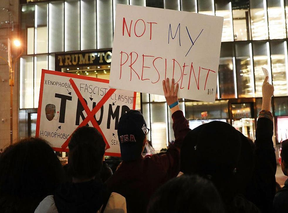 Dozens of anti-Donald Trump protesters stand along 5th Avenue in front of Trump Tower as New Yorkers react for a second night to the election of Trump as president of the United States on November 10, 2016 in New York City. Trump defeated Democrat Hillary Clinton to become the 45th president.