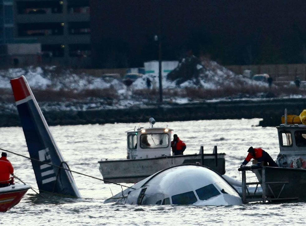 Rescue crews secure a US Airways flight 1549 floating in the water after it crashed into the Hudson River in 2009