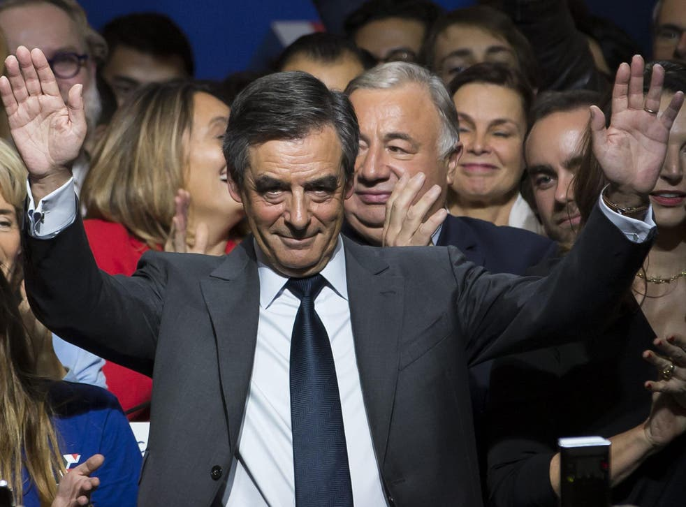 Francois Fillon waves during the national anthem during a political rally of the second round of the conservative presidential primary, in Paris, France, 25 November, 2016