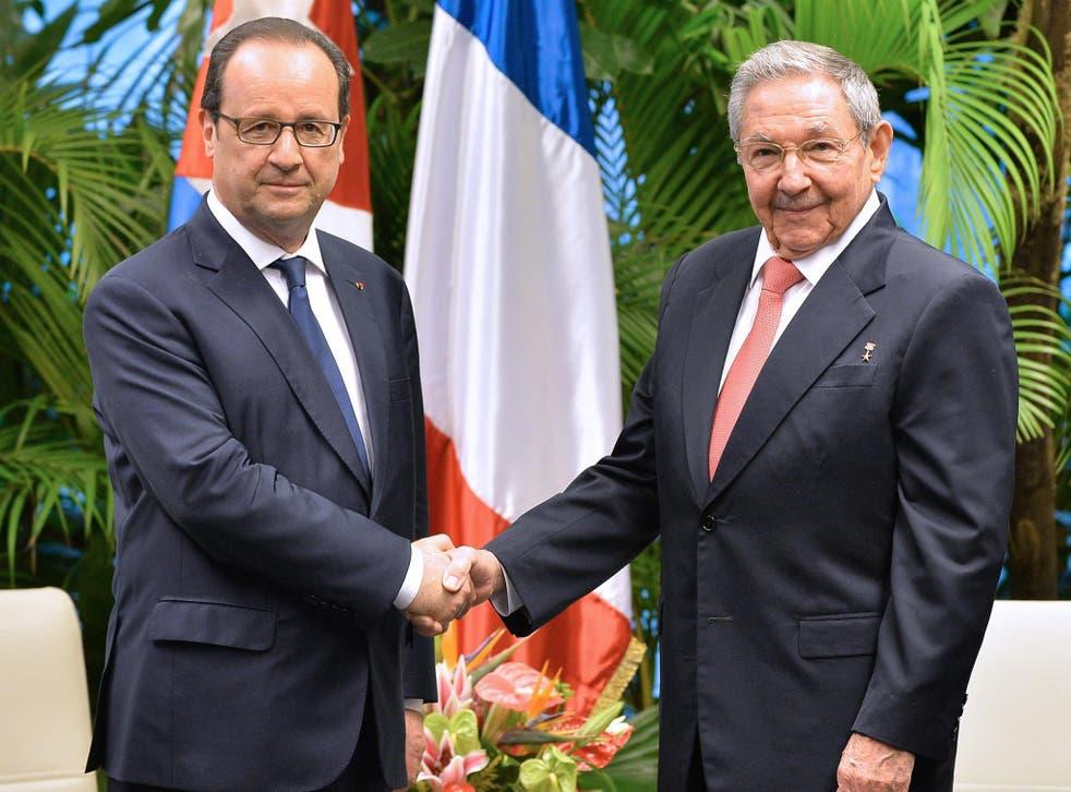 Francois Hollande (left) met Cuban president Raul Castro in Havana last year