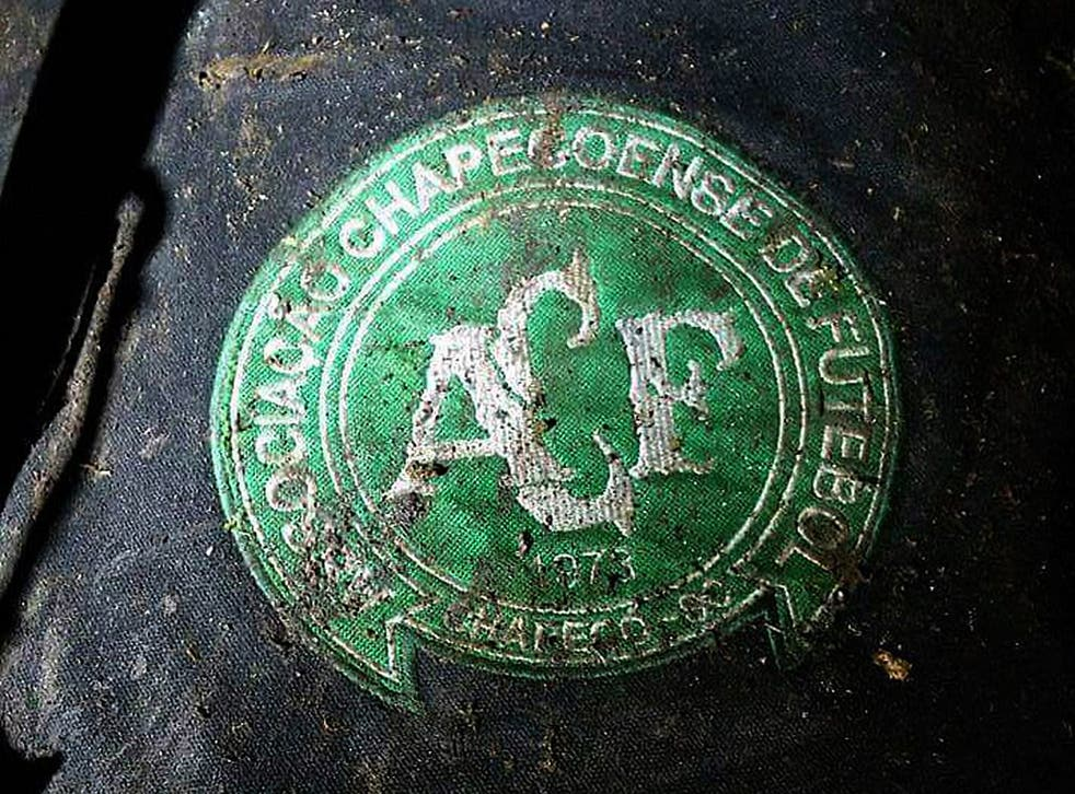 Logo of the Brazilian football team Chapeconese at the site of the plane crash near Medellin in Colombia