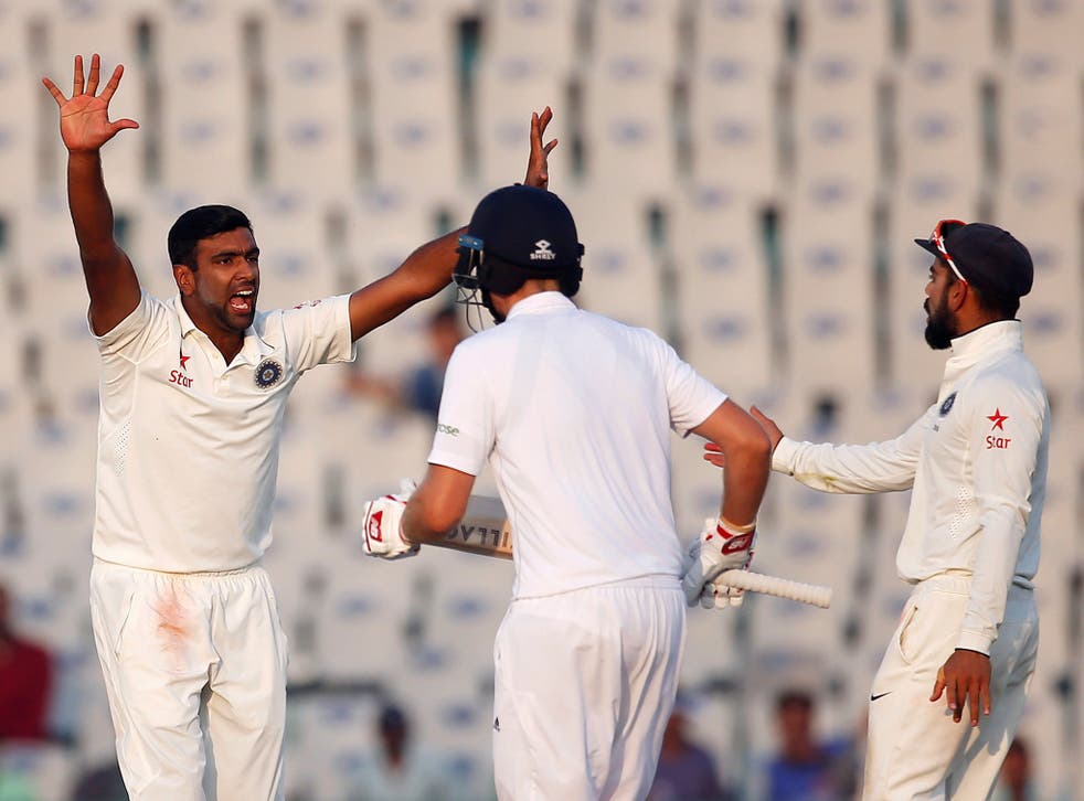 India's Ravichandran Ashwin (L) appeals successfully for the dismissal of England's Ben Stokes on the fourth day of the Third test