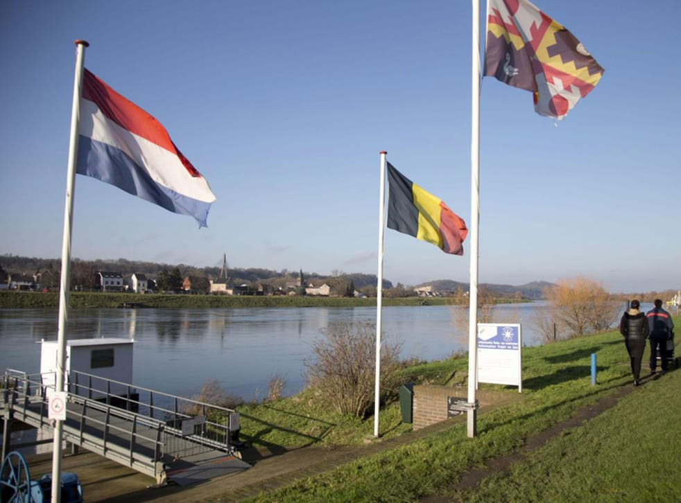 File photo showing the Dutch and Belgian flags on the waterfront in Eijsden, Netherlands