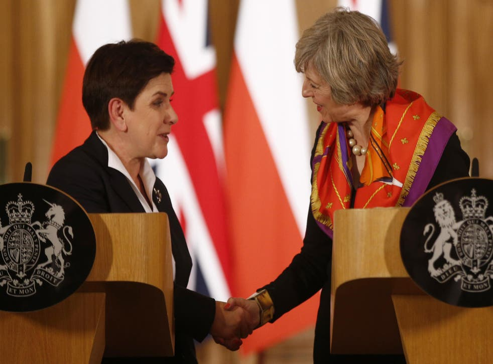 Britain's Prime Minister Theresa May (R) and her Polish counterpart Beata Szydlo hold a joint news conference in 10 Downing Street in central London, Britain November 28, 2016
