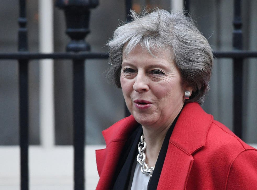 Theresa May leaves Downing Street for Prime Minister's Questions in the Commons