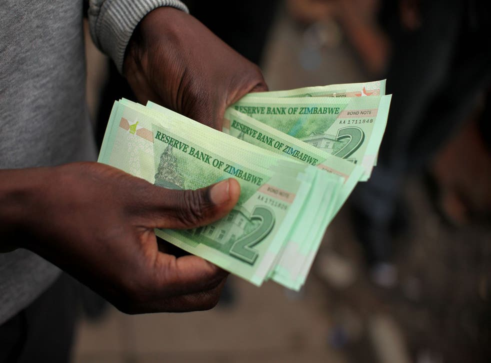 A man holds bond notes released by the Reserve Bank Of Zimbabwe in Harare central business centre on November 28, 2016