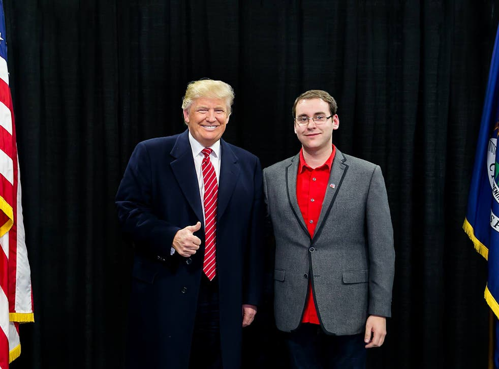 Brandon Hall standing with President-elect Donald Trump