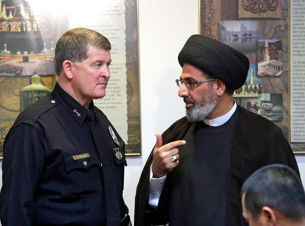 Los Angeles Police Deputy Chief Michael Downing meets with Iman Sayed Moustafa al-Qazwini at the Islamic Educational Center of Orange County to discuss the spate of threatening letters