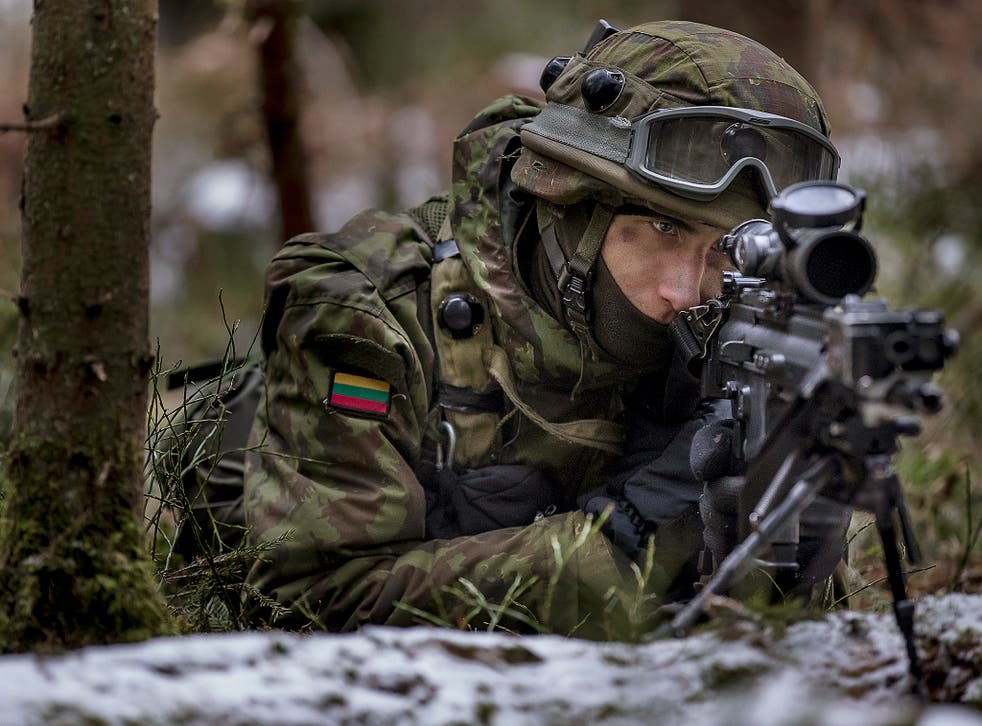 A Lithuanian soldier practices during a NATO military exercise, 'Iron Sword,' at the Rukla military base some 130 km (80 miles) west of the capital Vilnius, Lithuania