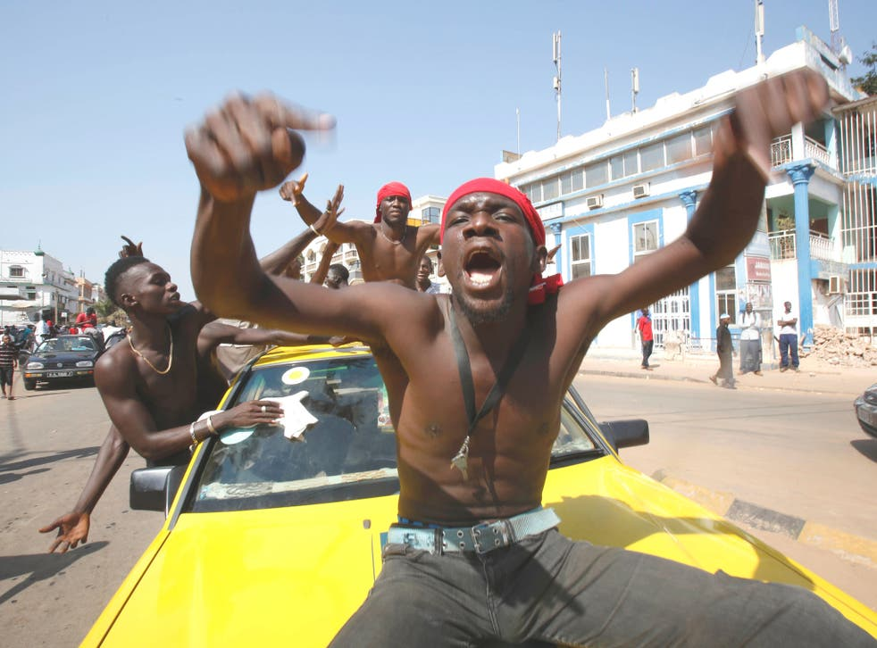 Supporters of President-elect Adama Barrow celebrate his victory in Banjul