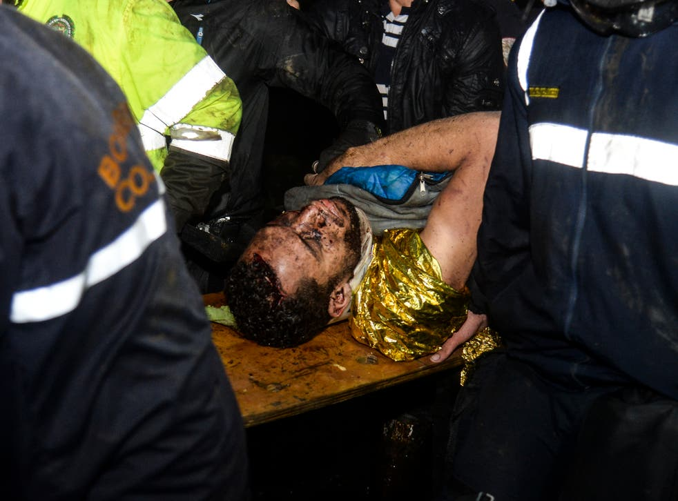 The player was helped by paramedics after being pulled from the wreckage of the Colombia plane crash