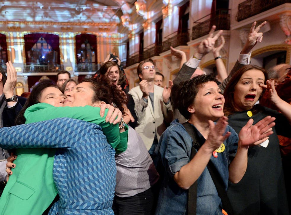 Austrians celebrate the eventual result of the presidential election