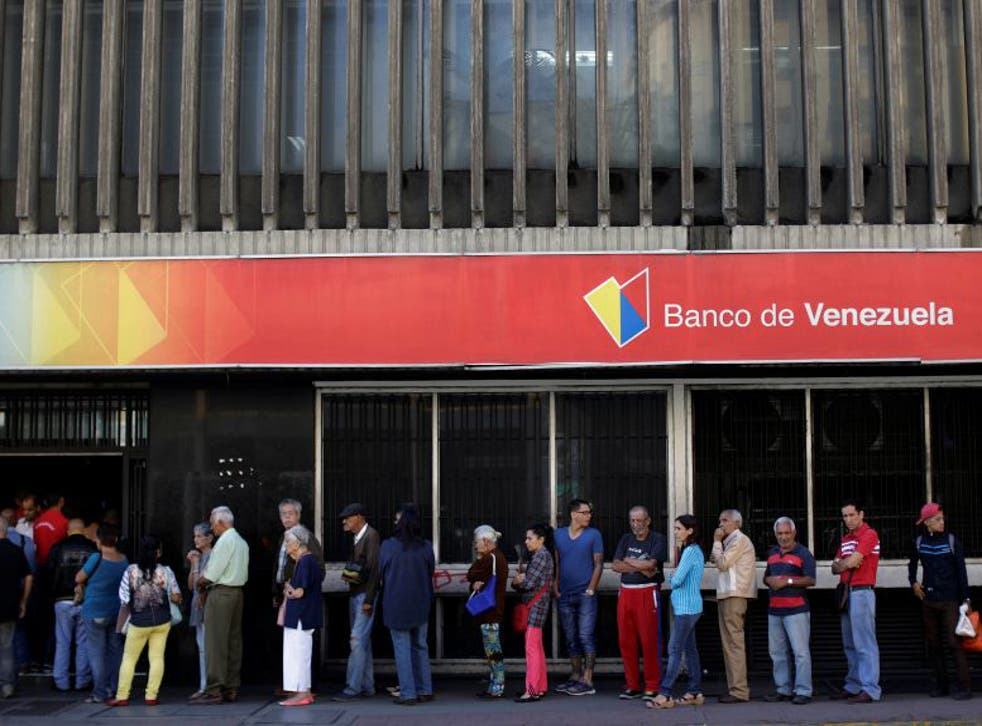 A bank in the Venezuelan capital, Caracas. The country has only $10bn in reserves left