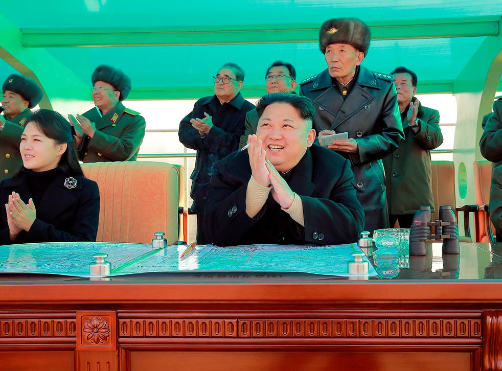 Kim Jong Un and his wife Ri Sol-ju attend a combat flight contest in Pyongyang