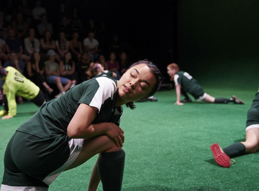 Nine girls on the football pitch, testing themselves and creating their identities