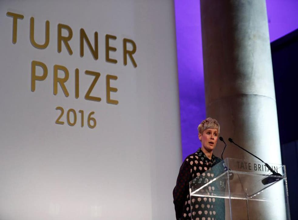 Helen Marten accepts her prize at the Tate Gallery in London