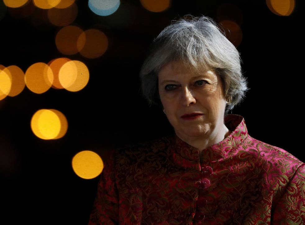Theresa May attends a reception in Bahrain