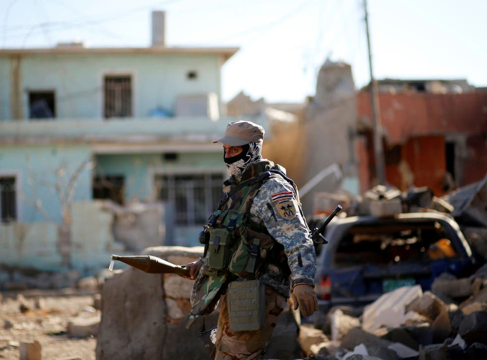 A member of the Iraqi security forces battling Isis near Mosul