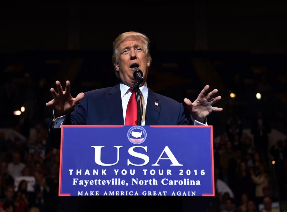US President-elect Donald Trump speaks at the Crown Coliseum in Fayetteville, North Carolina on December 6, 2016 during his USA Thank You Tour