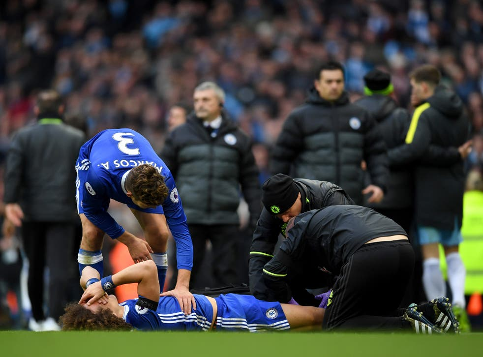 Luiz was left writhing in pain after the reckless challenge by Aguero