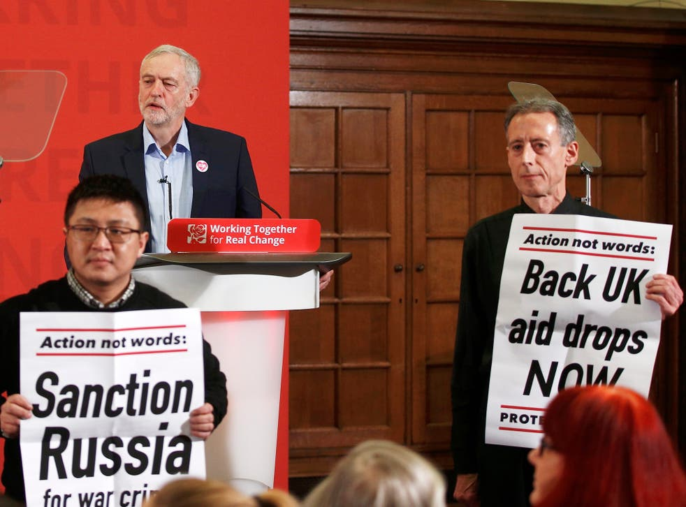 Peter Tatchell (right) leads protesters disrupting a speech by Jeremy Corbyn to demand more action in Aleppo, in London on 10 December