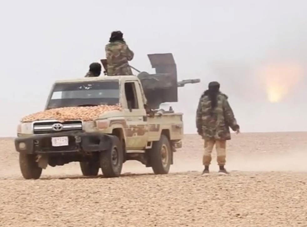 Isis fighters attacking the Syrian army on the outskirts of Palmyra on 9 December