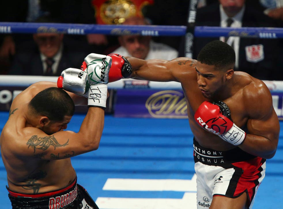 Anthony Joshua throws a punch at opponent Eric Molina